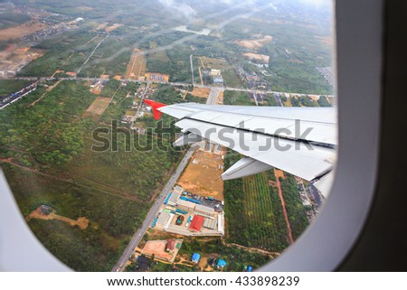 View of the rural from plane window, selective focus - stock photo