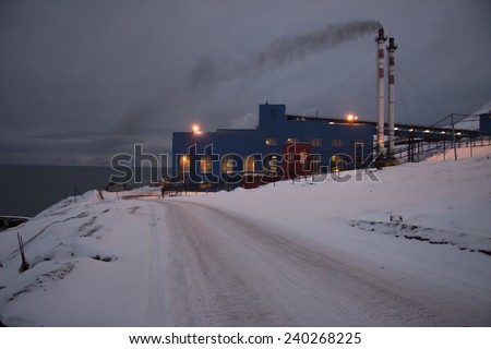 View of the Russian mining settlement on Spitsbergen in the far north during the polar night, the view from the top of the boiler house chimney visible - stock photo