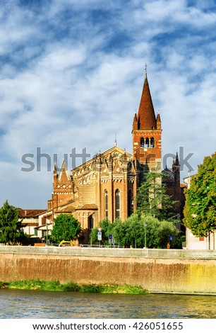 View of the Saints Fermo and Rustico church from the Adige River in Verona, Italy. Verona is a popular tourist destination of Europe. - stock photo