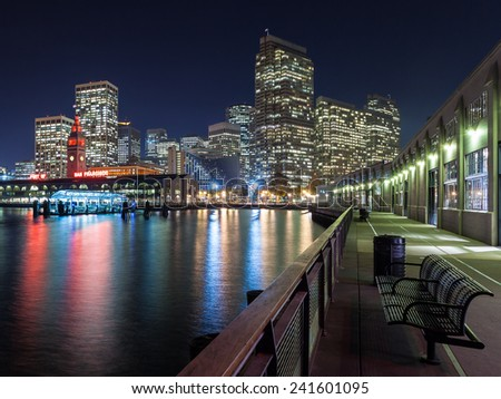 View of the San Francisco skyline at night from one of the piers. - stock photo