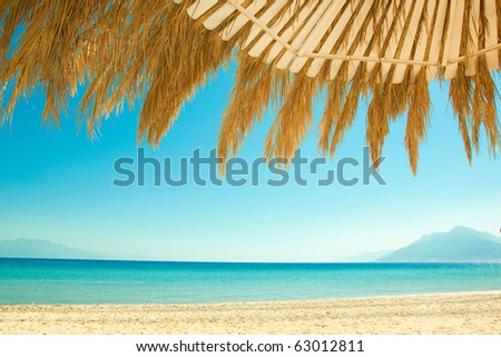 view of the sandy beach and turquoise sea - stock photo