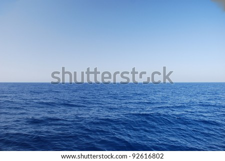 view of the sea and the wide horizon in the summer and holiday - stock photo