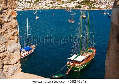 view of the sea with yachts through the wall of the castle in Bodrum, Turkey - stock photo