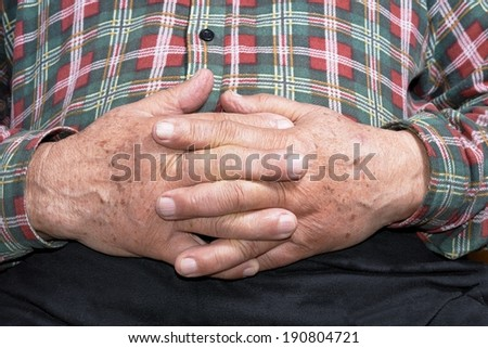 View of the senior hands in shirt