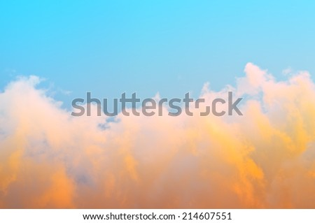 View of the sky above the clouds at sunset. - stock photo