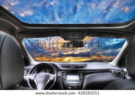 view of the sky from inside a car - stock photo