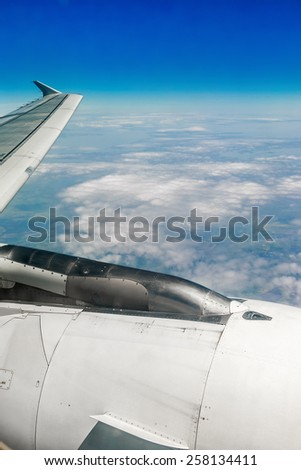 view of the sky from the plane. Focus on airplane engine