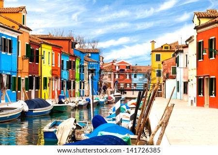 View of the small village of Burano with its multicolored buildings -  Venetian lagoon, Italy. - stock photo