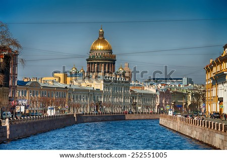View of the St. Isaac's Cathedral, the surrounding streets, waterfront canal and houses - stock photo