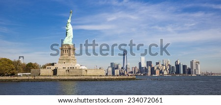 View of the Statue of Liberty with Manhattan skyline on the background. - stock photo