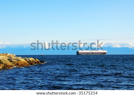 View of the strait and ship in sunset, victoria, british columbia, canada