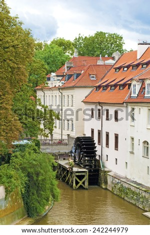 View of the street in the old town with water mill in Prague, Czech Republic. The capitals of Europe. - stock photo