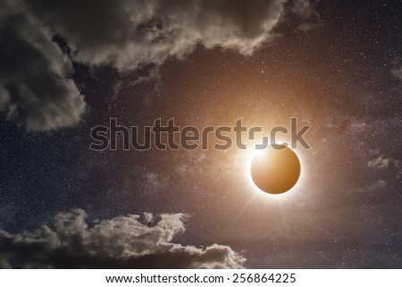 View of the sun during a full moon eclipse 'Elements of this image furnished by NASA' - stock photo
