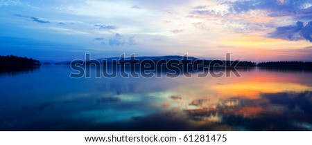 view of the sunset over the lake - stock photo