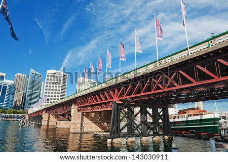 View of the Sydney Pyrmont Bridge and skyscrapers in Sydney - stock photo