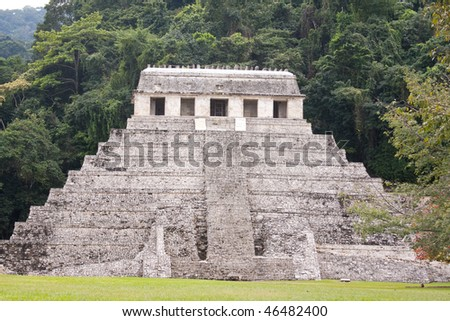 View of the Temple of Inscriptions with steamy jungle behind it at the ancient Mayan city of Palenque. Chiapas, Mexico. - stock photo