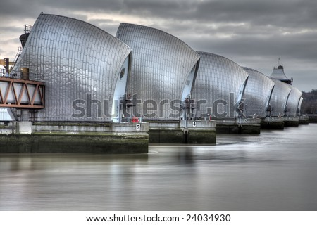 View of the Thames Barrier, showing six of the nine concrete piers. Thames Barrier is the world's second largest movable flood barrier, located downstream of central London in the area of Silvertown. - stock photo
