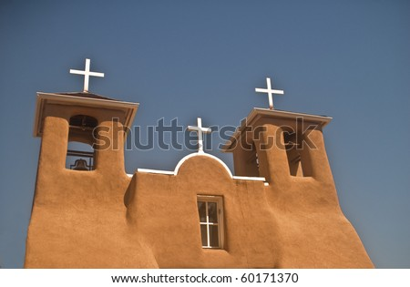 View of the Three Crosses on the historic San Francisco de Assisi church at Rancho de Taos in New Mexico - stock photo