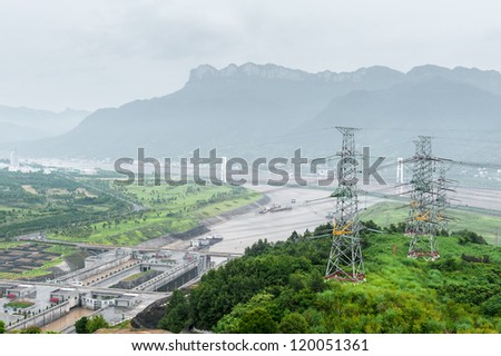 View of the Three Gorges Dam on the Yangtze River in China in misty ambiance - stock photo
