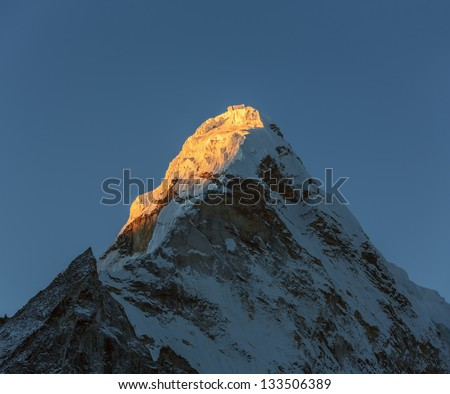 View of the top of the Ama Dablam (6814 m) from the valley of the Chhukhung in morning - Nepal, Himalayas - stock photo