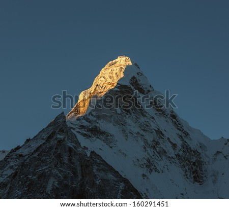 View of the top of the Ama Dablam (6814 m) from the valley of the Chhukhung in the sunrise (view from Chhukhung Ri) - Nepal, Himalayas