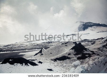 view of the top of volcano Etna in spring, everything is covered with snow - stock photo