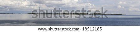 View of the Toronto Islands from the southern pier overlooking Lake Ontario - stock photo