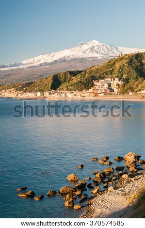 View of the touristic village Giardini Naxos, Eastsicily, in the early morning with a view of Mount Etna