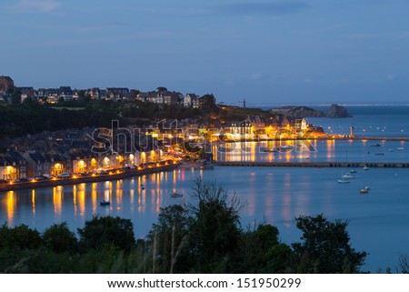 View of the town and port of Cancale, France at night