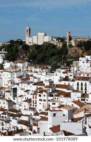 View of the town and surrounding countryside, pueblo blanco, Algatocin, Costa del Sol, Malaga Province, Andalusia, Spain, Western Europe. - stock photo