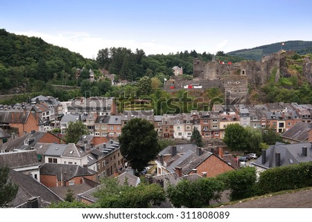 View of the town centre below its medieval Castle in Belgian City of La Roche. La Roche-en-Ardenne is a Walloon municipality of Belgium located in the province of Luxembourg. - stock photo