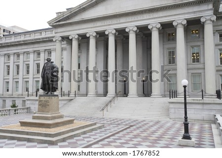 View of the United States Treasury Department in Washington, DC.  Greek revival architecture building with statue of Treasury Secretary Albert Gallatin (1761 - 1849) on left. - stock photo