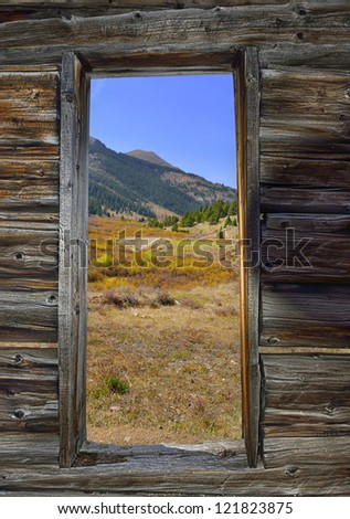 view of the valley from the door of the abandoned house in the ghost town of Colorado during fall - stock photo