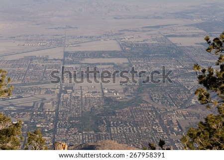 View of The valley from the top of the San Jacinto Mountains in California with a very dense and thick smog layer