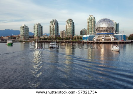 View of the Vancouver skyline of Science World and nearby buildings from the water of False Creek - stock photo