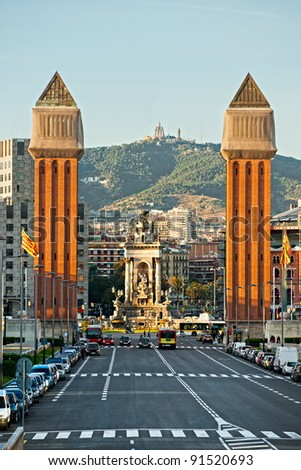 View of the Venetian Tower on Espanya square,, Tibidabo on background. barcelona. Spain. - stock photo
