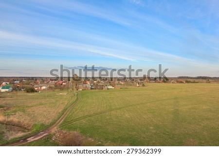 View of the village at the lake from height. The village at the lake. Lodges in the village on the bank of the lake  - stock photo