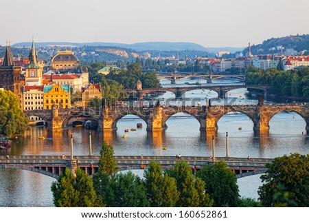 View of the Vltava River and the bridges shined with the sunset sun, Prague, the Czech Republic - stock photo