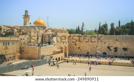 View of the Wailing Wall and on the gold-plated Dome Rock Al-Aqsa, Temple Mount, minaret, Jerusalem. Israel - stock photo