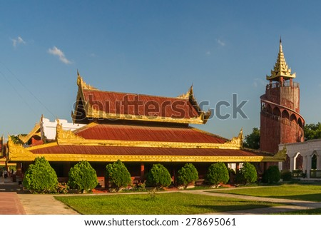 View of the watchtower and other buildings at the Mandalay Royal Palace compound - stock photo