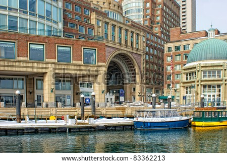 View of the water taxis and arched entrance to  Historic Rowe's Wharf from inside the wharf in the south end of Boston Massachusetts in winter. - stock photo