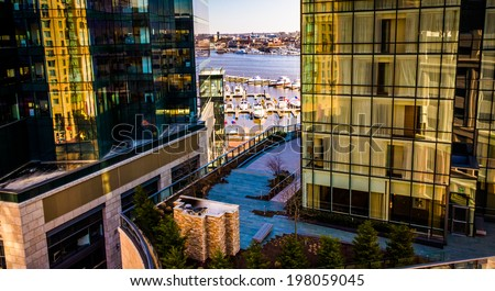 View of the waterfront and modern buildings in Harbor East from a parking garage, Baltimore, Maryland. - stock photo
