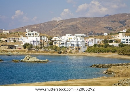 View of the waterfront from the beach in Greece - stock photo