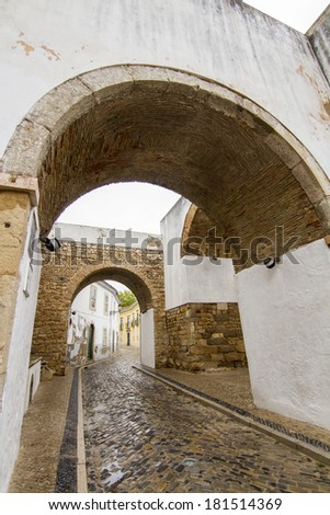 View of the well known arch entrance of Faro city, Portugal.