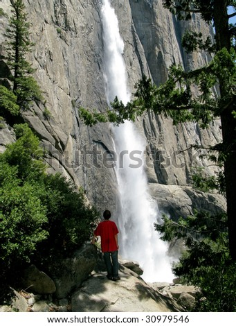 View of the Yosemite Falls from hike alongside the waterfall - stock photo