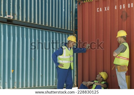 View of three construction workers taking a break - stock photo