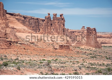 View of Three Gossips along North Park Avenue in Arches National Park, Utah, USA - stock photo