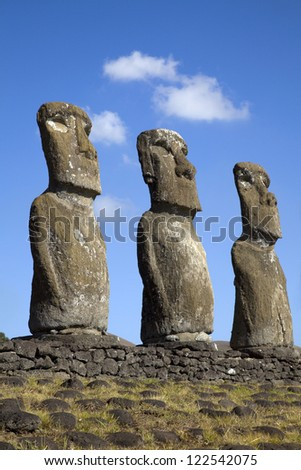 View of three of the seven Ahu Akivi Moai, which are the only Moai to face the sea, Rapa Nui, Easter Island, Chile. - stock photo