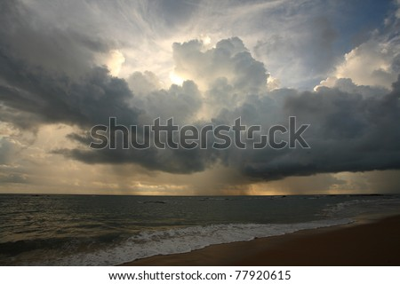 View of thunderstorm clouds above the sea - stock photo