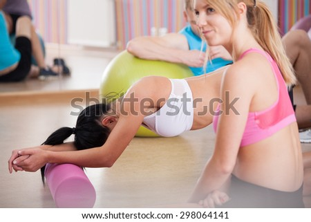 View of tired girls after pilates training - stock photo